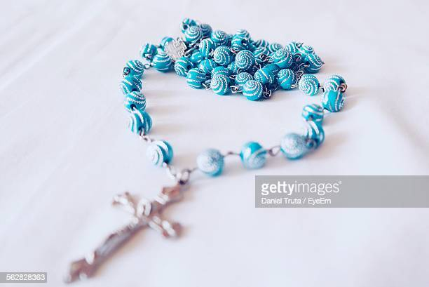 Close-Up Of Rosary Beads On Table