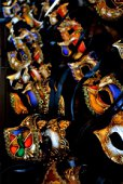Close-up of rows of Venetian masks