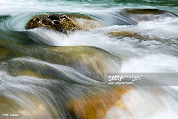 Closeup of rushing water or Newhalem Creek, North Cascades. Washington. USA