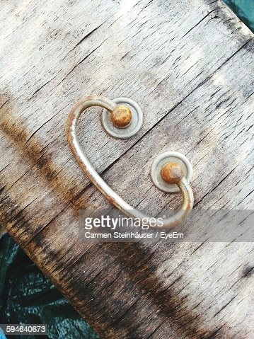 Close-Up Of Rusty Handle On Wooden Plank