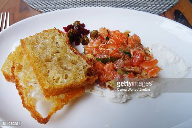 Close-Up Of Salmon Tartare With Toasted Bread