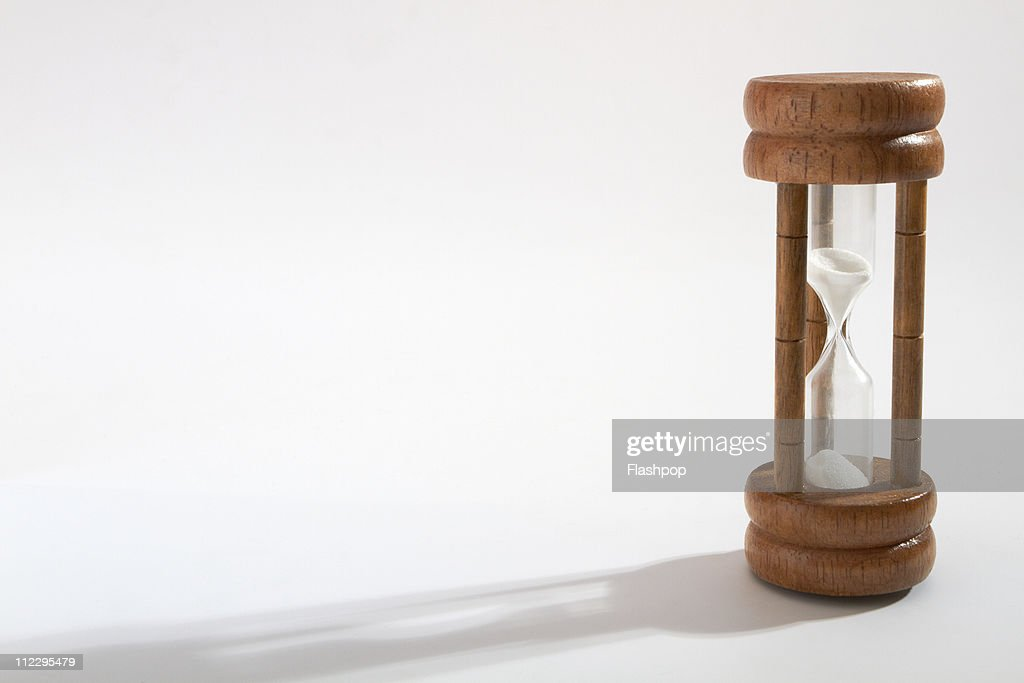Close-up of sand falling through egg timer : Stock Photo
