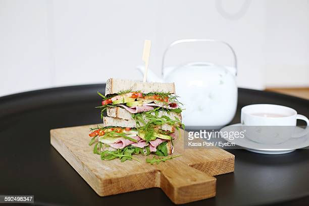 Close-Up Of Sandwich And Coffee On Table