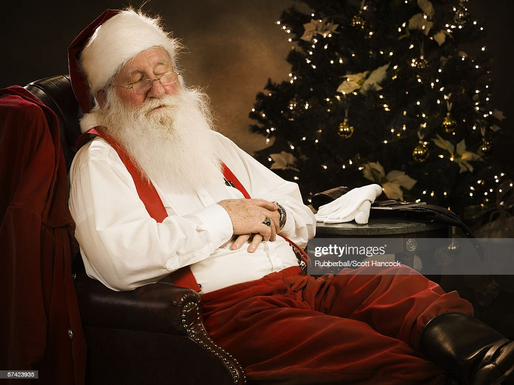 closeup of santa claus sleeping on a chair stock photo getty images