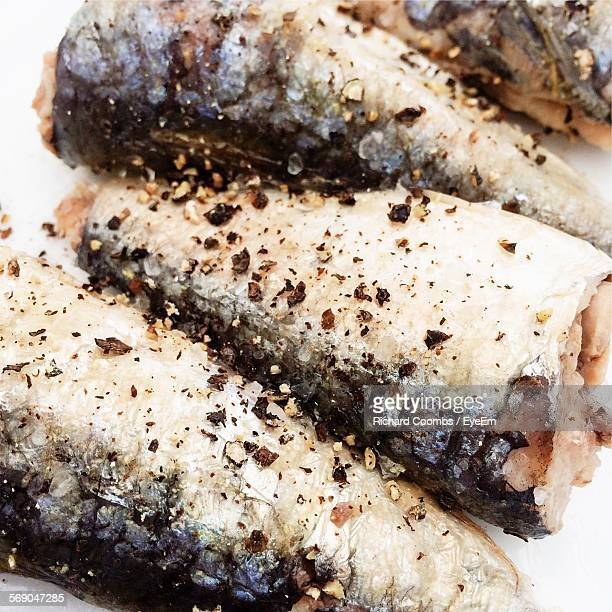 Close-Up Of Sardines Seasoned With Black Pepper