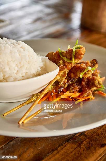 Close-Up Of Satay With Rice Served On Table