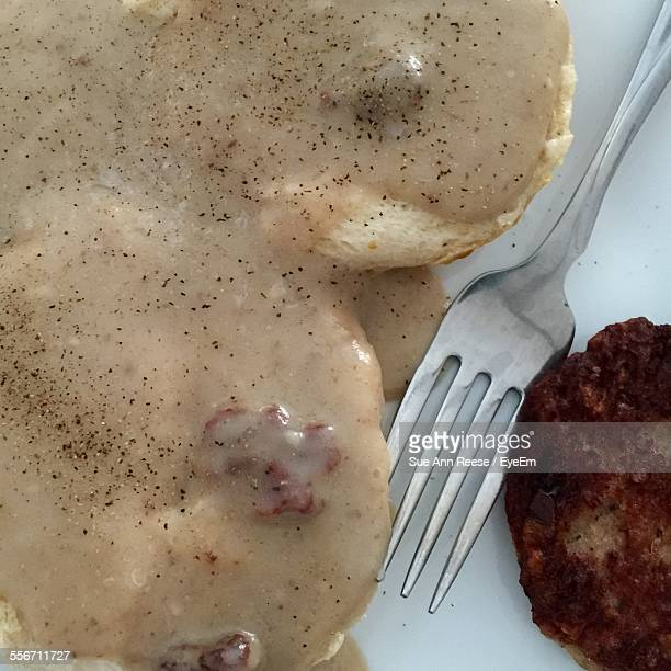 Close-Up Of Sausage Gravy And Biscuit In Plate