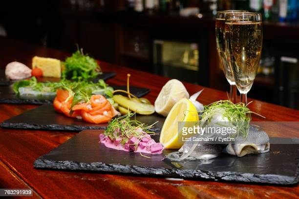 Close-Up Of Sea Food Served On Slate At Table In Bar