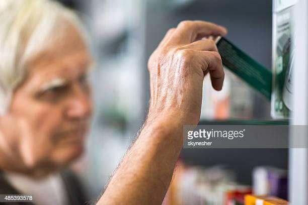 Close-up of senior man choosing a medicine.