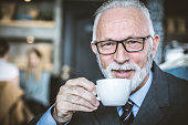 Close-up of senior man drinking coffee.
