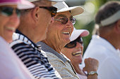 Close-up of senior spectators watching an event