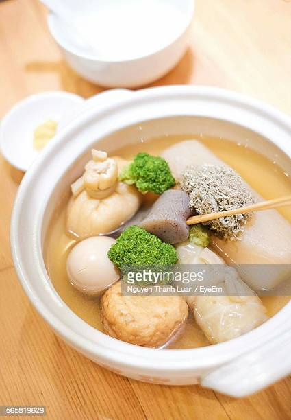 Close-Up Of Served Broth With Dumplings And Pork Belly