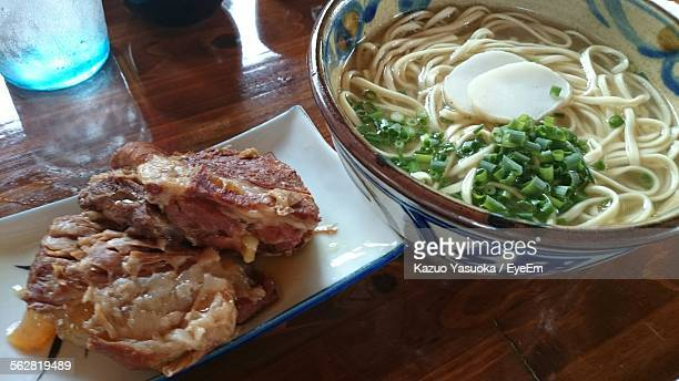 Close-Up Of Served Noodle Soup With Sweet Pie