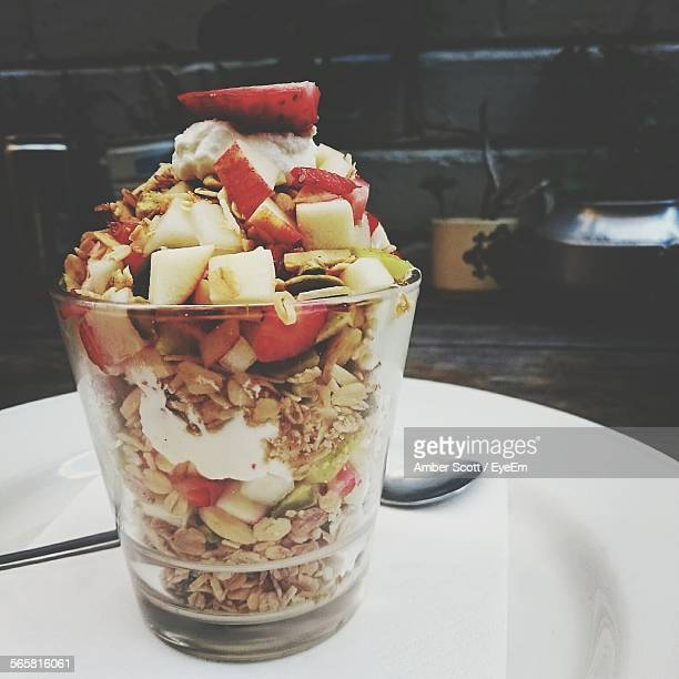 Close-Up Of Served Oats And Chopped Fruits In Glass