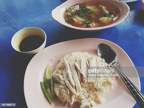 Close-Up Of Serving Boiled Rice With Chicken Slice And Soup