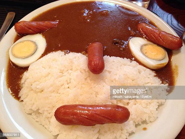 Close-Up Of Serving Boiled Rice With Sausage