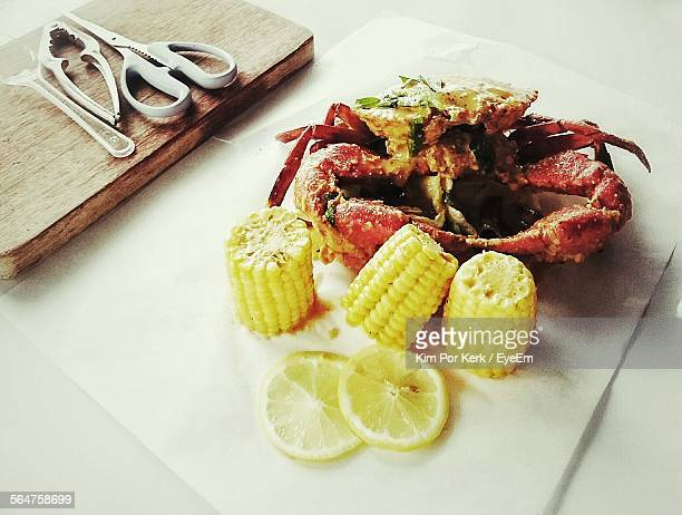 Close-Up Of Serving Seafood With Boiled Corns