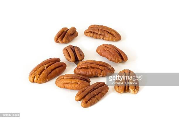 Closeup of several pecan peanuts