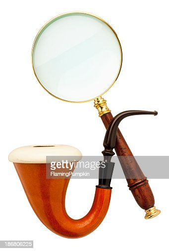 Close-up of Sherlock Holmes pipe and magnifier