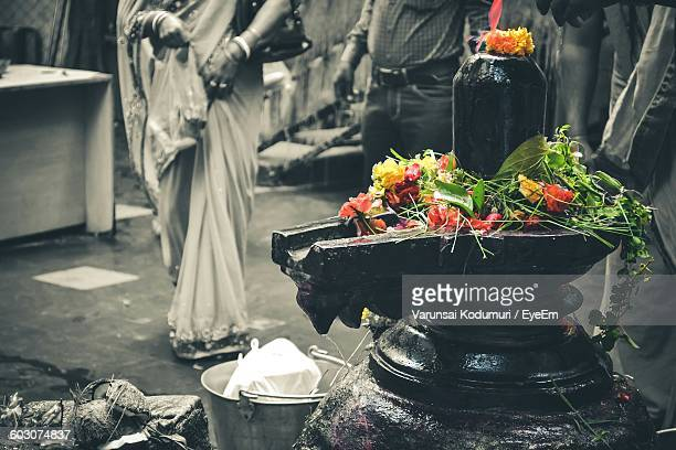 Close-Up Of Shiva Linga With Flowers In Temple