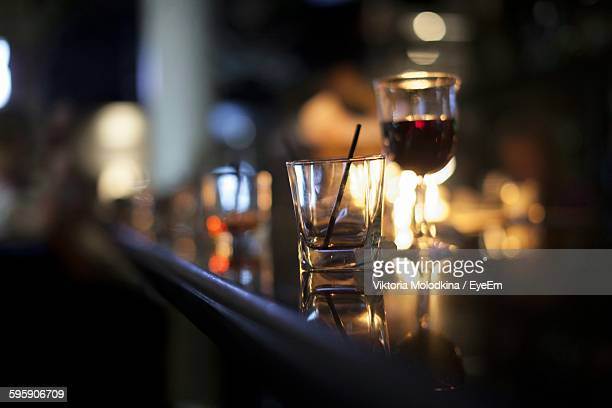 Close-Up Of Shot Glass On Bar Counter At Nightclub