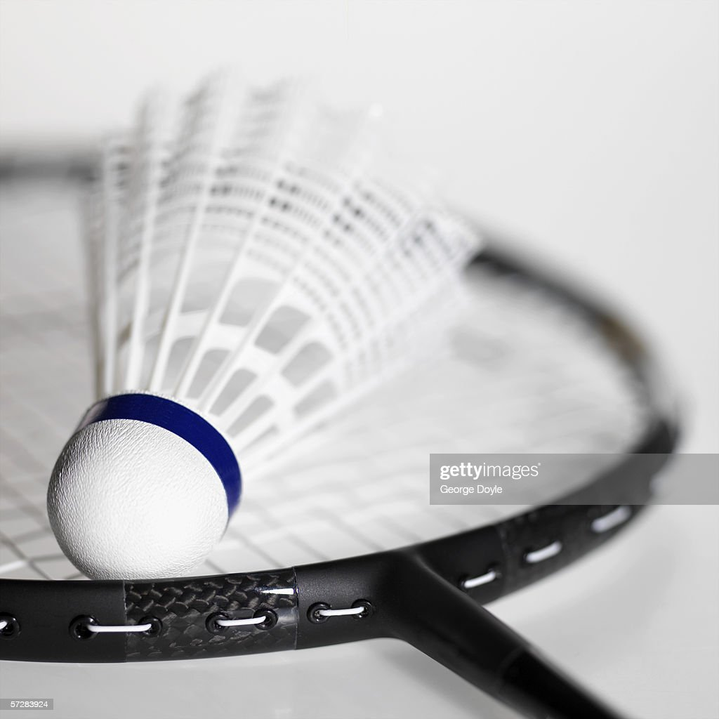 Close-up of shuttlecock on a badminton racket