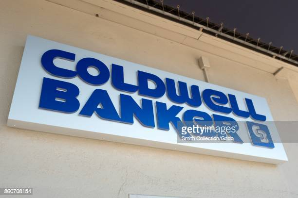 Closeup of sign with logo for real estate company Coldwell Banker in the Gourmet Ghetto neighborhood of Berkeley California October 6 2017