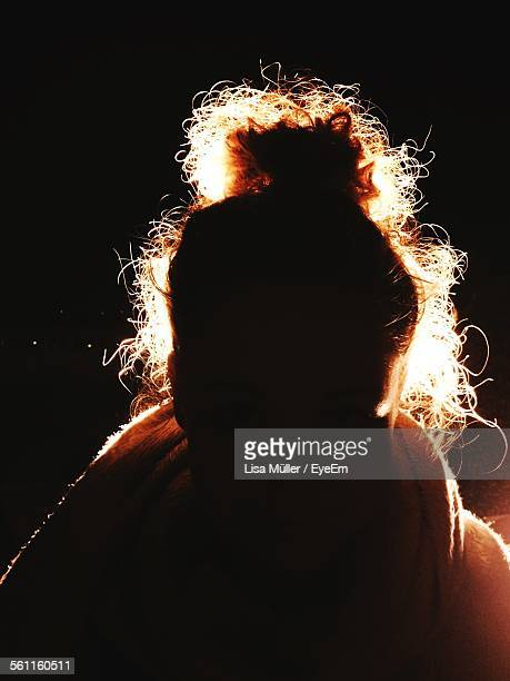 Close-Up Of Silhouette Girl Over Black Background