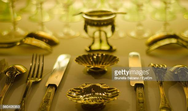 Close-Up Of Silverware Arranged On Table