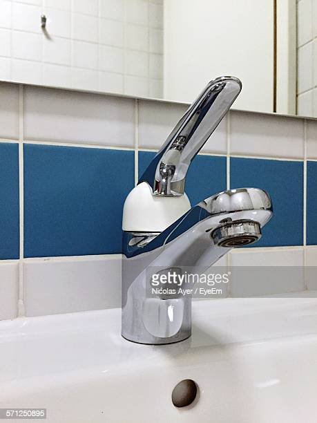 Close-Up Of Sink Faucet In Bathroom