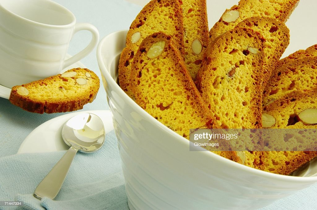 Close-up of slices of almond cake in a bowl : Stock Photo