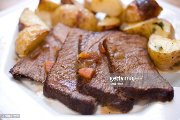 Close-up of slices of beef with potatoes