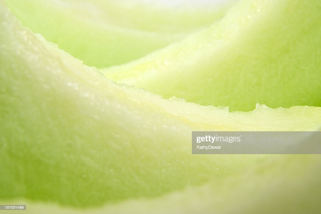 A close-up of slices of fresh, ripe honeydew melon