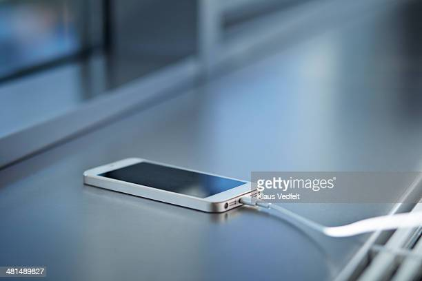 Close-up of smartphone charging