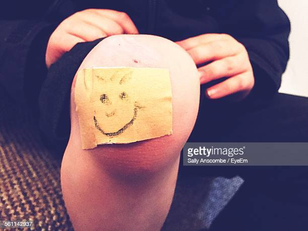 Close-Up Of Smiley Face On Adhesive Bandage
