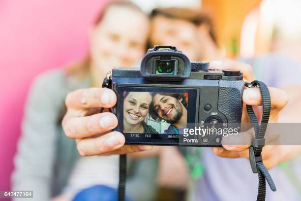 Close-up of smiling couple taking selfie on camera