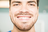 Closeup portrait of smiling mid adult man at dental clinic