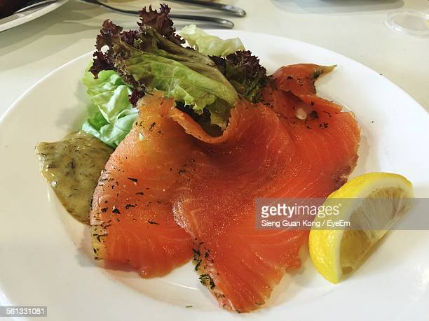 Close-Up Of Smoked Salmon With Slice Of Lemon In Plate