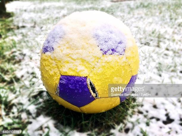 Close-Up Of Snow Covered Football On Field
