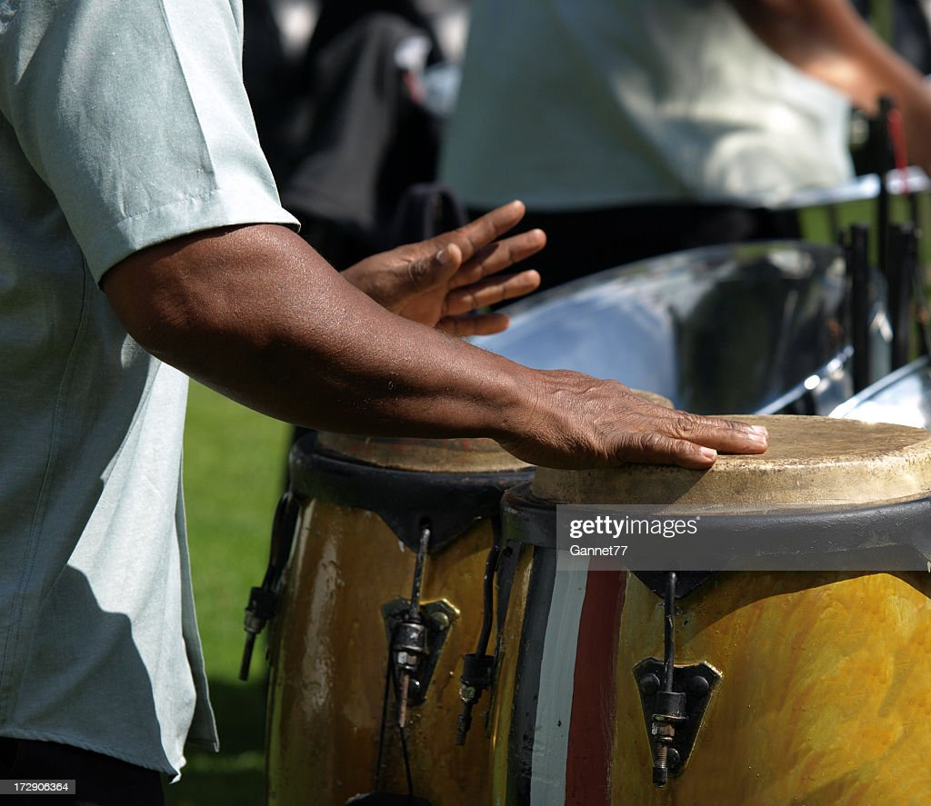 Close-up of some male drummer hands playing the bongos