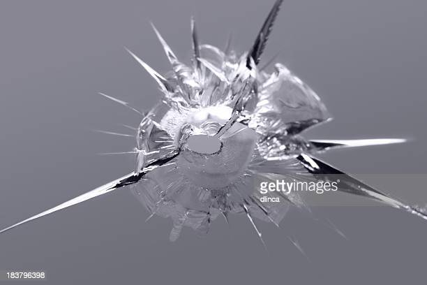Close-up of some shattered glass on gray background