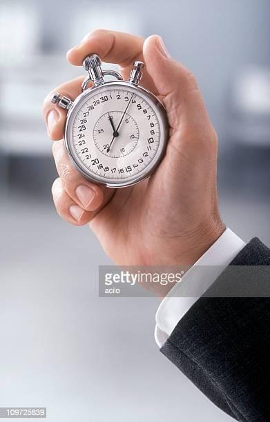 Mano con classico Cronometro