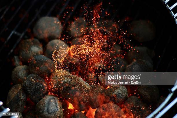 Close-Up Of Sparks Rising From Barbecue Grill