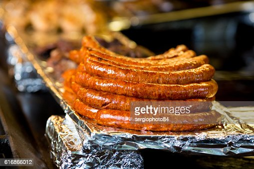 Close-up of spicy browned sausages on the hot flat : Stock Photo