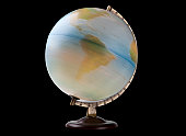 Close-up of spinning globe over black background