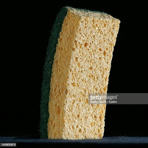 Close-Up Of Sponge Against Black Background