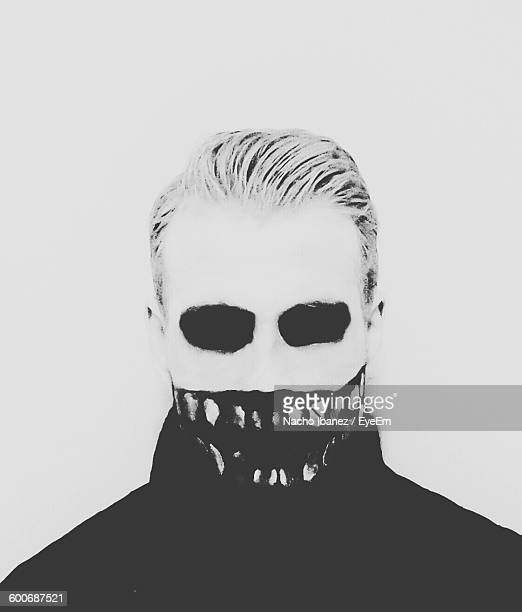 Close-Up Of Spooky Man Standing Against White Background During Halloween