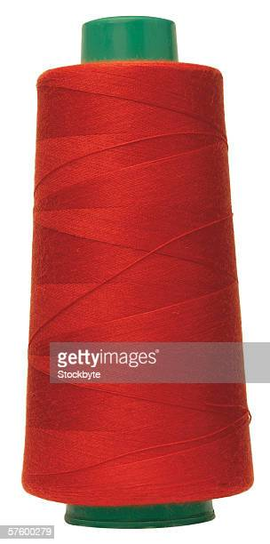 close-up of spool of red thread