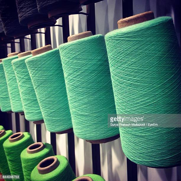 Close-Up Of Spool Of Threads In Factory