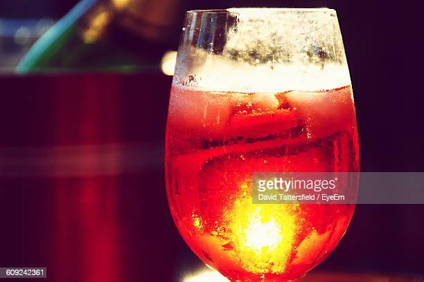 Close-Up Of Aperol Spritz In Glass On Table